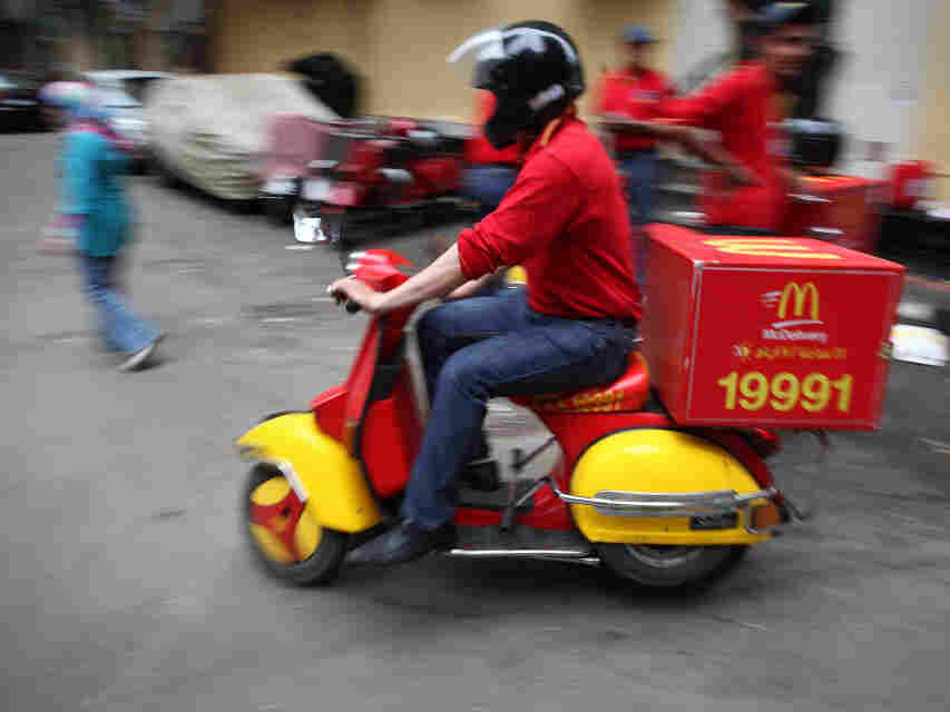 A Big Mac on two wheels? Egypt, pictured here, is one of 15 countries where the fast-food giant McDonald's delivers.
