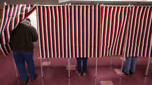 Voters cast ballots in the New Hampshire primary on Tuesday. Elections in the U.S. have historically been held on Tuesdays, but some now wonder if the day might prevent some Americans from voting.