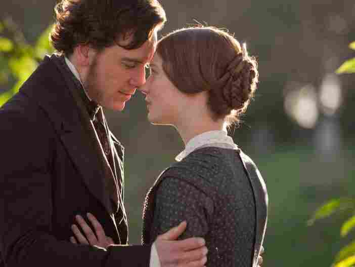 Michael Fassbender (left, with Mia Wasikowska) is Jane's employer and eventual lover, Rochester, in Jane Eyre.