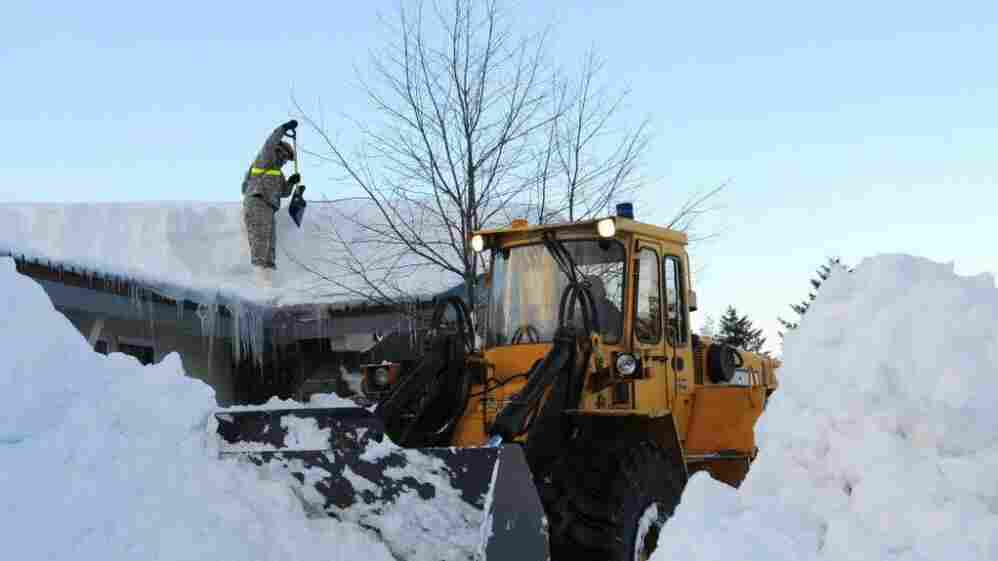 Jan. 9: An Alaska National Guardsman clears a roof in Cordova.
