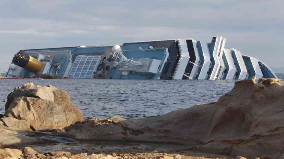 The cruise ship Costa Concordia leans on its side off the Tuscan island of Giglio, Italy.