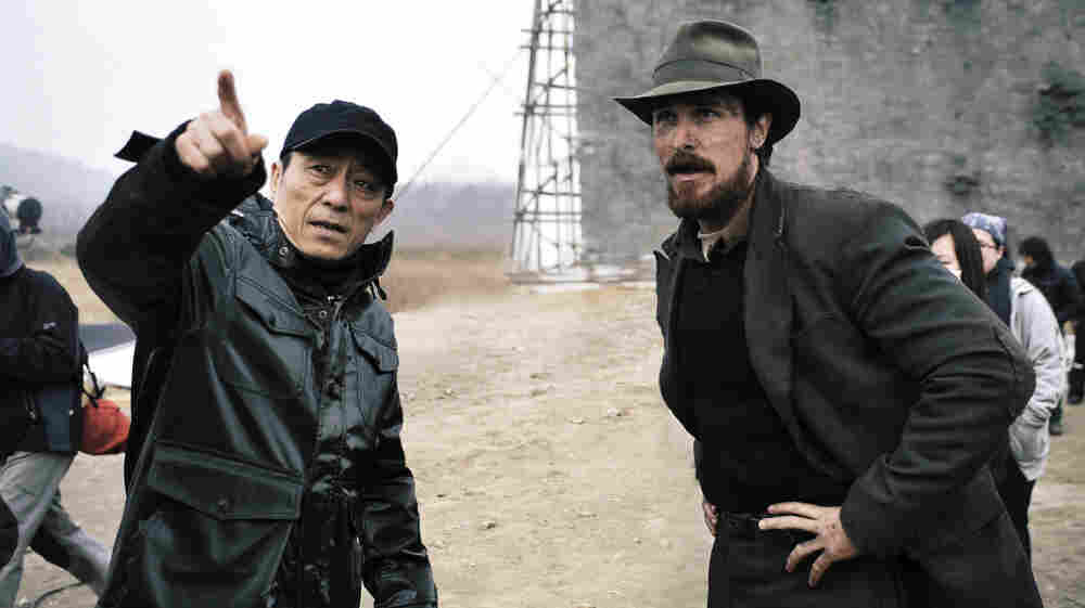Director Zhang Yimou (left) and actor Christian Bale on the set of The Flowers of War.