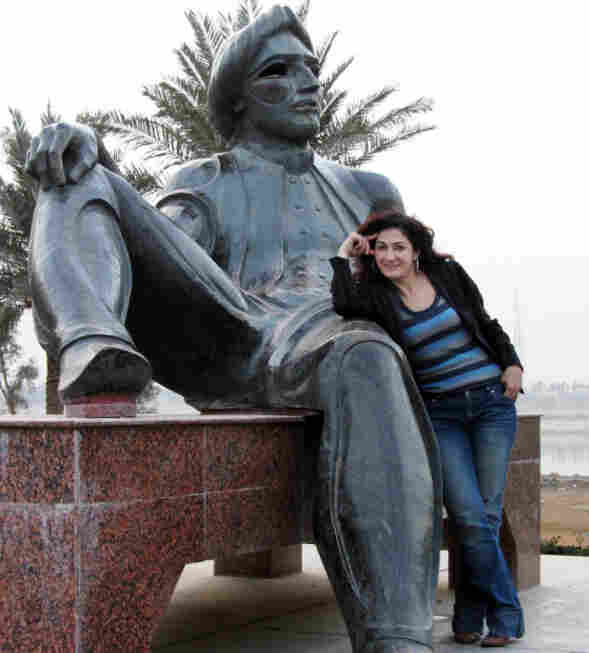 After a 20-year absence, Aseel Albanna returned to her native Iraq and found a very different country. Here, she poses with the statue of King Shahryar, a character in The Thousand and One Nights, near the Tigris River in Baghdad.