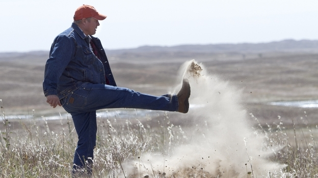 Atkinson, Neb., rancher Bruce Boettcher, who opposes the Keystone XL pipeline, kicks up sand on his land, to demonstrate the fragility of the sandhills near the planned route of the pipeline. (AP)