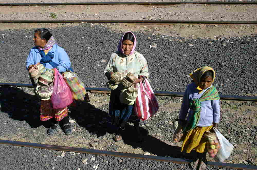 In this photo taken on Nov. 9, 2011, Tarahumara women are seen peddling goods to passengers of El Chepe, a government-run train.