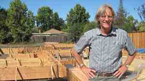 James Witt stands next to the foundation of a house he is building in Palo Alto. Witt has built a successful business by tearing down and rebuilding houses in Silicon Valley.