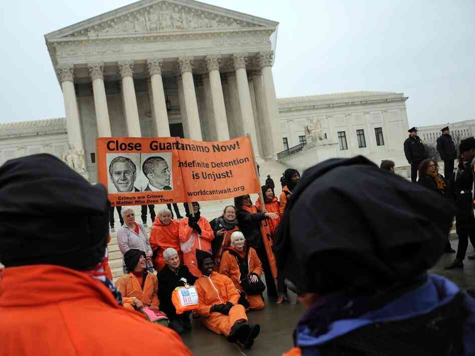 Members of the organization Witness Against Torture demonstrate outside the U.S. Supreme Court Jan. 11, 2012. Research suggests those who agree with Supreme Court decisions tend to have a favorable view of the Court, while those who don't, have a negative view.