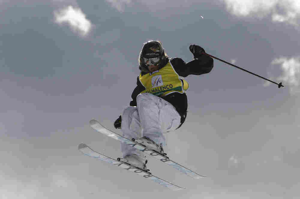 Sarah Burke of Canada is airborne as she competes in the women's halfpipe freestyle event at the World Cup finals in Valmalenco, Italy in 2008.