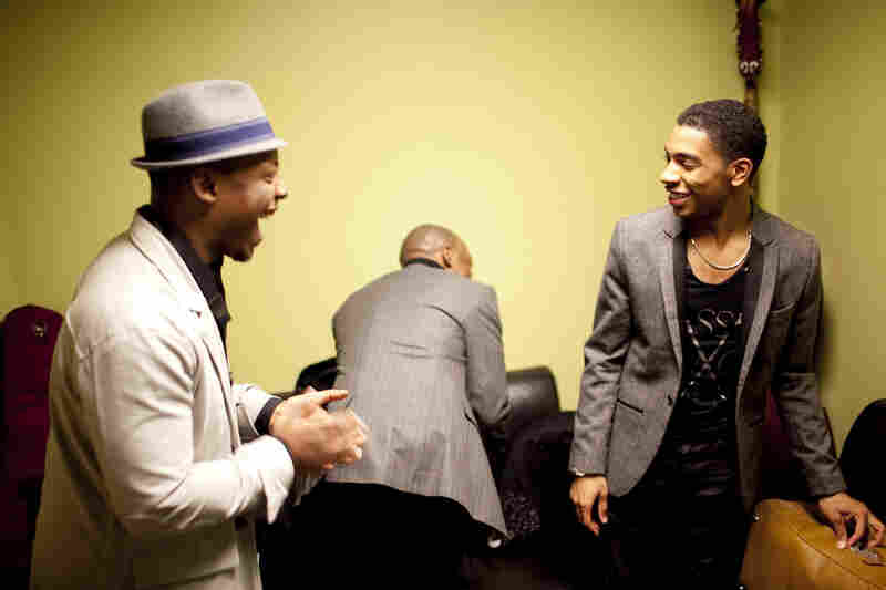 Marcus Strickland (left) speaks with Christian Sands, who performed in the previous set, backstage. Jaleel Shaw is in the background.