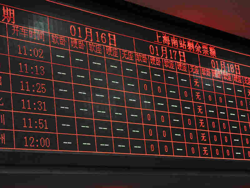 An electronic board at Shanghai Railway Station shows many trains sold out for Jan. 16-18. China's Rail Ministry spent more than $8 million on the ticketing website — which crashed and sometimes charged users without actually giving them tickets.