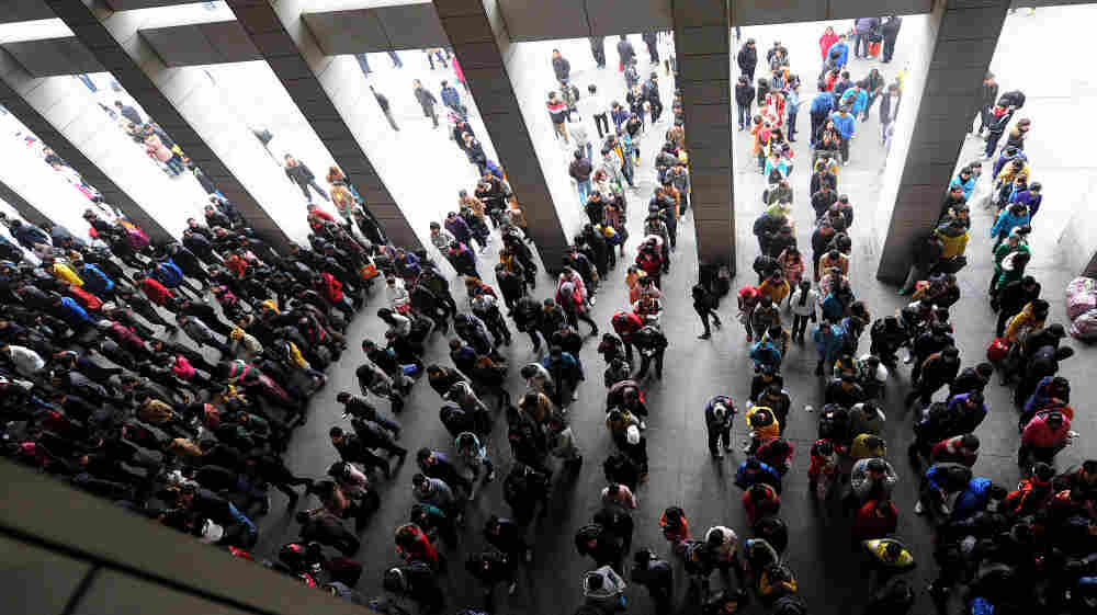 The scramble for train tickets for people traveling for the Lunar New Year, China's most important holiday, is always intense. The launch of an online ticketing system has created new headaches. Here, hundreds of people line up to buy train tickets at a railway station in Hefei in eastern China's Anhui province on Dec. 29, 2011.
