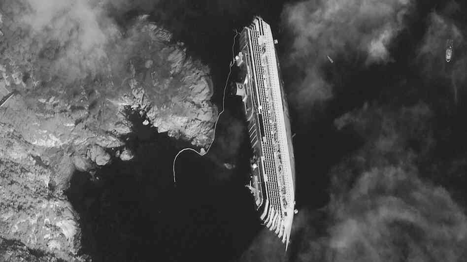 This satellite image taken Tuesday shows the hulk of the luxury cruise ship Costa Concordia, which ran aground off the tiny Tuscan island of Giglio.