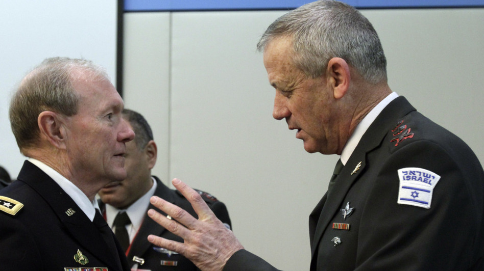 The chairman of the U.S. Joint Chiefs of Staff, Gen. Martin Dempsey (left), is in Israel to talk about the growing tension with Iran. Here, Dempsey speaks with Israel's top military officer, Lt. Gen. Benjamin Gantz, during a meeting at NATO headquarters in Brussels on Wednesday.