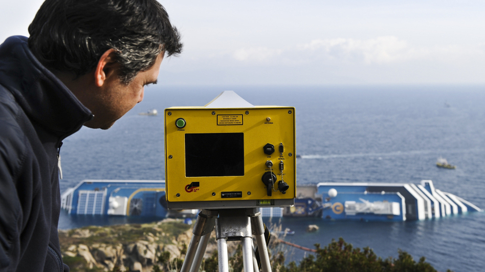 Technician Andera Faccioli positioned a laser-equipped device to determine whether the Costa Concordia has shifted position off the Tuscan island of Giglio, Italy. (AFP/Getty Images)