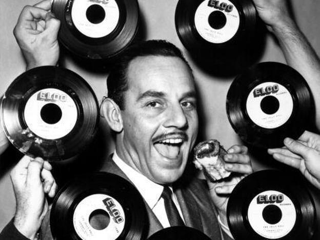 "Band leader Johnny Otis poses for a portrait in surrounded by ""The Jelly Roll"" records in 1947. </p"