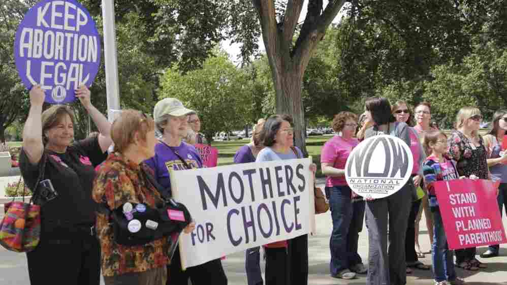 Protesters against new regulations limiting abortion rights rally outside the Statehouse in Topeka, Kan., last Sept.