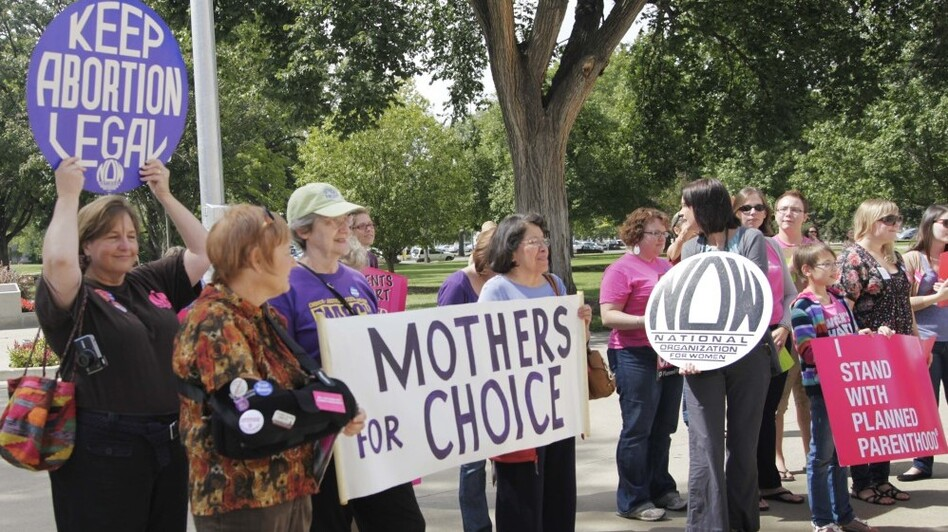 Protesters against new regulations limiting abortion rights rally outside the Statehouse in Topeka, Kan., last Sept. (AP)