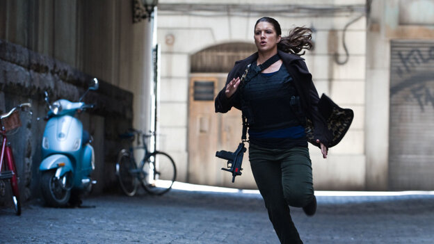 Mixed martial arts fighter Gina Carano stars as Mallory Kane, a highly trained covert operative, in a twisty, tautly wrought thriller.