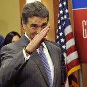 Texas Gov. Rick Perry salutes after announcing that he is suspending his campaign as a Republican presidential candidate.