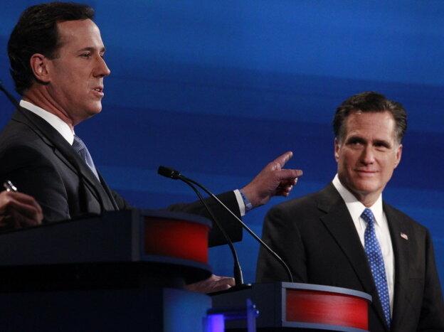 Republican presidential candidates Rick Santorum (left) and Mitt Romney during a debate in S
