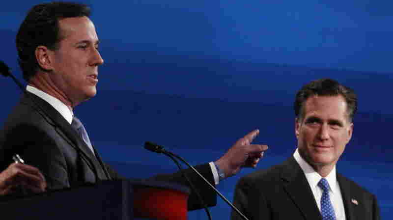 Republican presidential candidates Rick Santorum (left) and Mitt Romney during a debate in South Carolina on Monday.