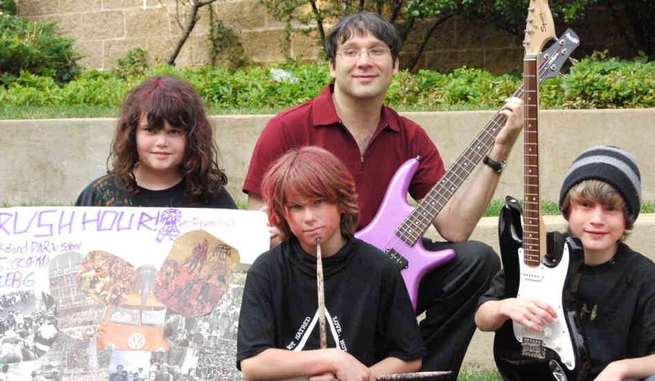 Gary Marcus plays bass in the band Rush Hour, which is made up of 11-year-olds (left to right: Sarah, Riley and Ryan) that he met at band camp.