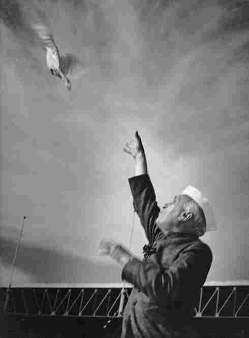 """Jawaharlal Nehru, India's first prime minister, releases a pigeon at the National Stadium in Delhi in the mid-1950s. Vyarawalla's favorite subject was Nehru, whom she refered to as """"photogenic."""""""