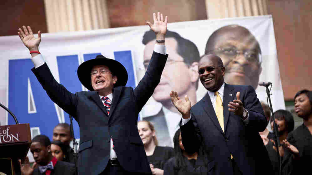 Comedian Stephen Colbert, left, holds a rally with former GOP presidential candidate Herman Cain at the College of Charleston in South Carolina.