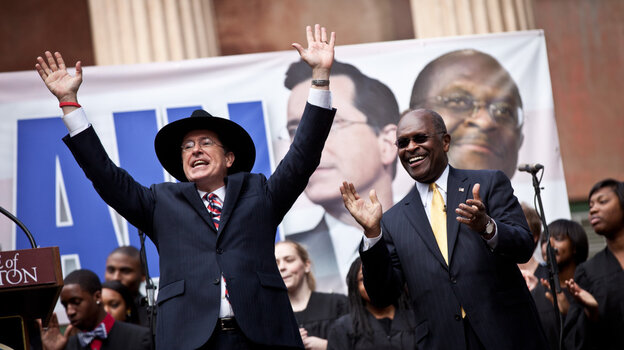 Comedian Stephen Colbert, left, holds a rally w