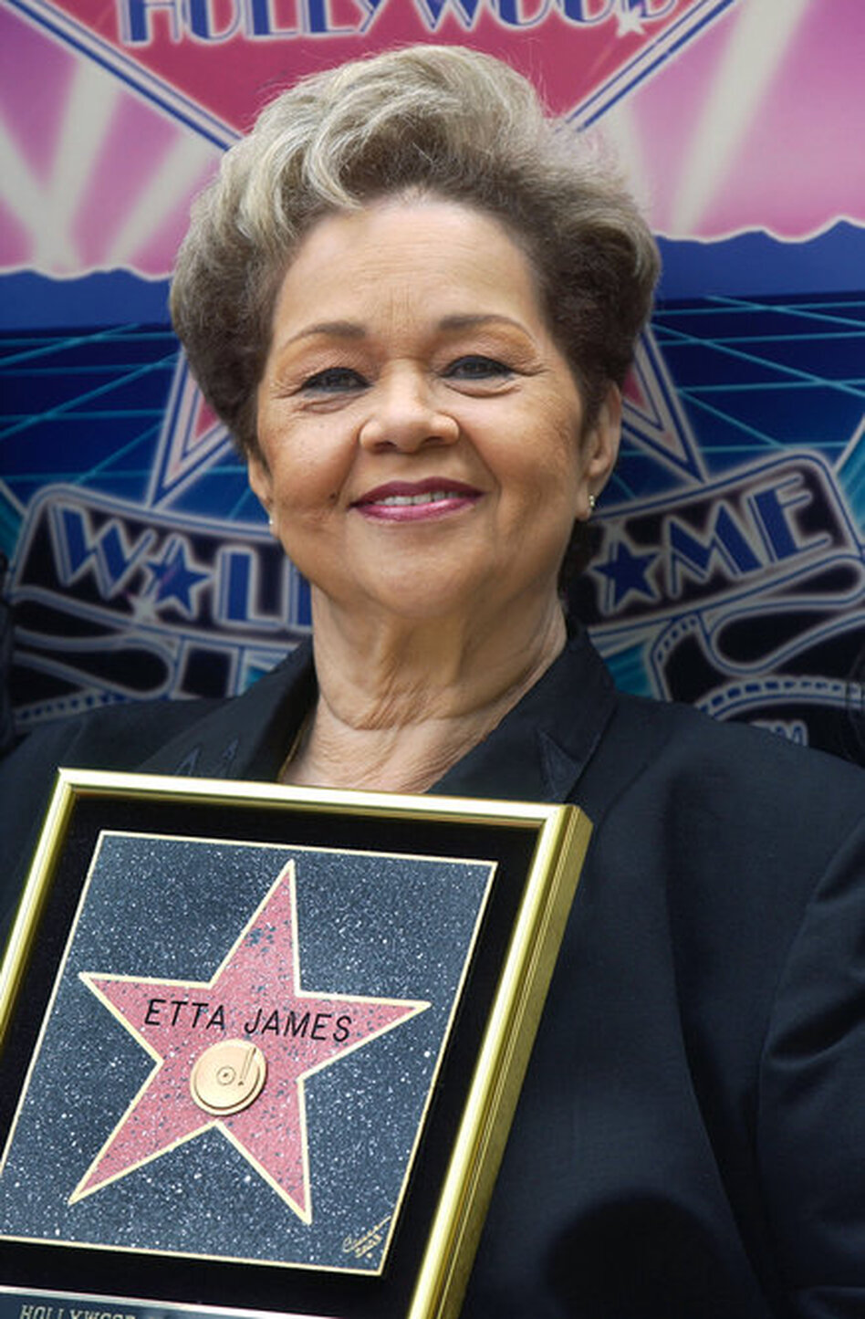 Singer Etta James displays her star during a ceremony honoring her on the Hollywood Walk of Fame April 18, 2003 in Hollywood, California.  (Getty Images)