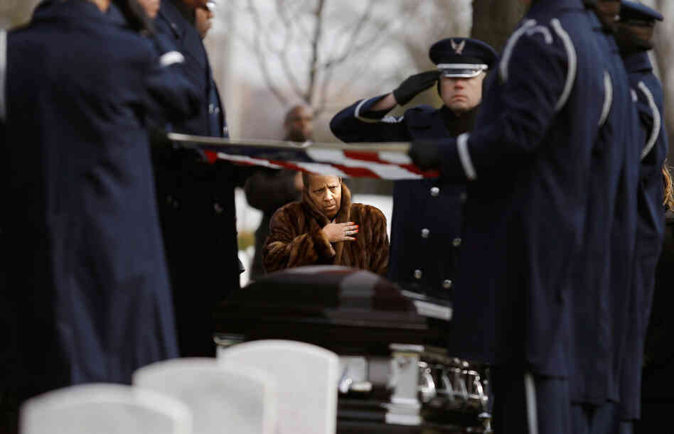 Family, friends and admirers salute the casket of Luke Weathers, Jr., one of the original Tuskegee airmen, at his burial ceremony at Arlington National Cemetery.