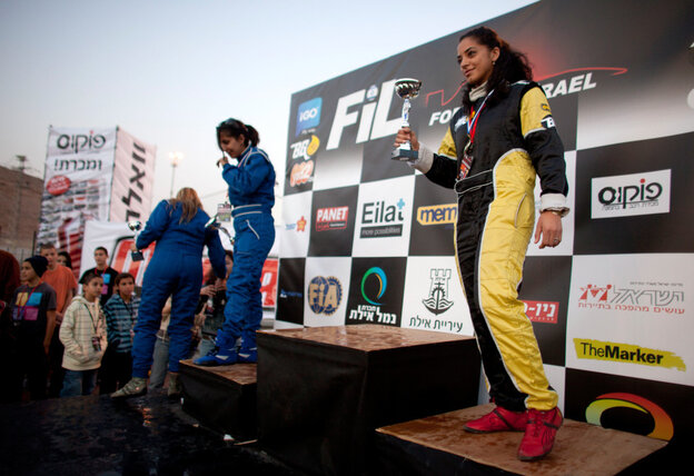 Noor Daoud holds a trophy after she won third place in the first day of Formula Israel's women's race, in Eilat, Israel. Daoud went on to take the women's title at the event.