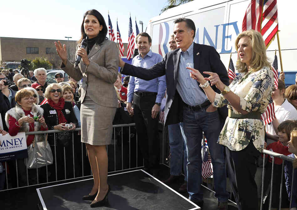 Mitt Romney and his wife, Ann, wish a happy birthday to South Carolina Gov. Nikki Haley (left) at Romney's campaign headquarters in Charleston, S.C., on Thursday.