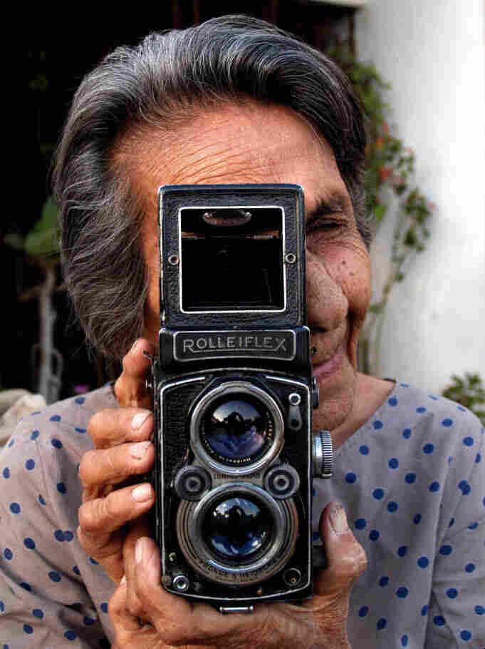 Homai Vyarawalla poses with her Rolleiflex camera at her home in Vadodara, India, on March 6, 2006.