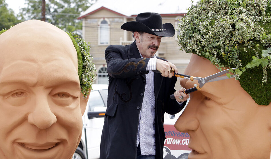 Kinky Friedman trims the ivy growing as hair on a 6-foot bust of Gov. Rick Perry. In 2006, Friedman came in fourth in his bid to be governor of Texas, drawing in part on his fame as a country musician. He has also written several mystery novels.  (AP)