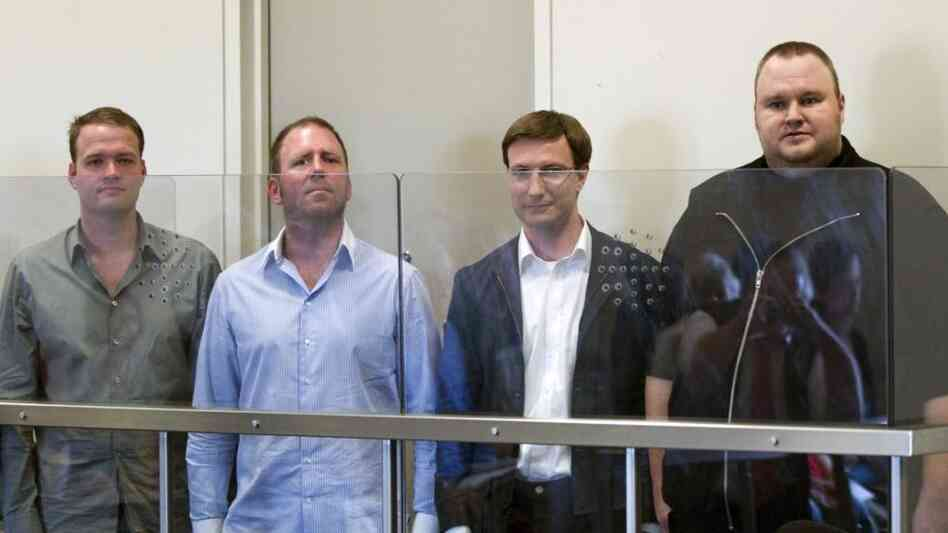 Bram van der Kolk, Finn Batato, Mathias Ortmann and Kim Schmitz, also known as Kim Dotcom, (from left to right) are remanded in custody in New Zealand on Friday.