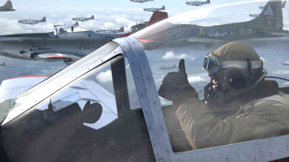 "Escorting a squadron of bombers, Andrew ""Smokey"" Salem (Ne-Yo) signals fellow pilots on the way into combat with German forces in the new film Red Tails, based on the experiences of the famed Tuskegee Airmen fighter group."