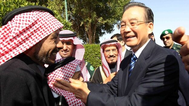 China appears to be rethinking its reliance on oil from Iran. Here, Chinese Premier Wen Jiabao (right) visits with the members of the Saudi Arabia-China Friendship Association on the outskirt of Riyadh, Saudi Arabia, earlier this month. (Xinhua /Landov)