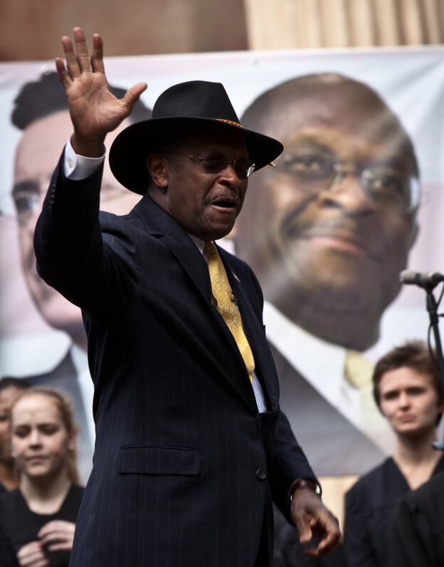 """Former GOP presidential candidate Herman Cain waves at a rally the College of Charleston on January 20, 2012. Comedian Stephen Colbert held the event with Cain, titled """"Rock Me Like a Herman Cain South Cain-olina Primary Rally"""", as part of his pseudo-run for president of """"The United States of South Carolina."""""""