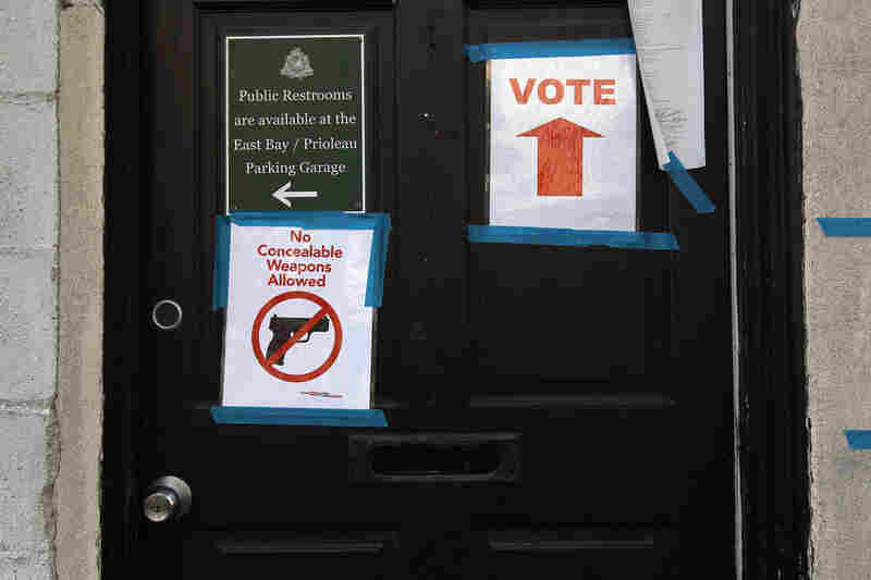 Signs adorn the doorway of a polling station in Charleston, S.C.