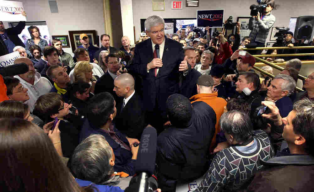 Newt Gingrich stands on an ice cooler while addressing the crowd at Tommy's Country Ham House.