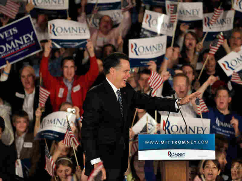Republican presidential candidate Mitt Romney waves as he takes the stage during his primary night rally Saturday in Columbia, S.C.