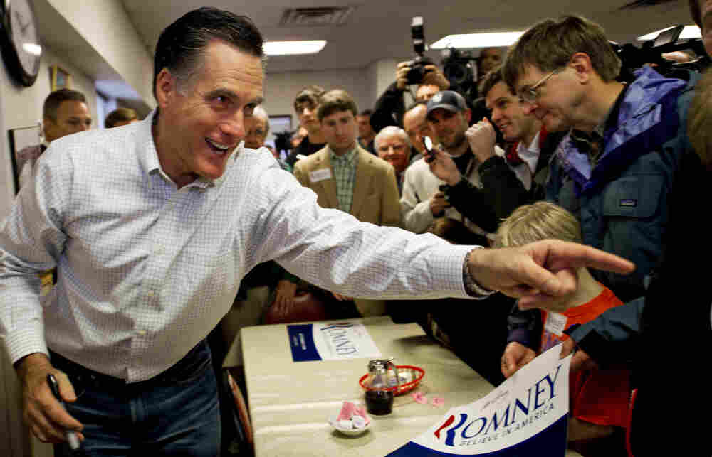 Mitt Romney signs autographs inside Tommy's Country Ham House in Greenville, S.C., on Saturday.