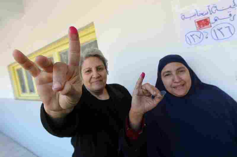 Egyptian women show their ink-stained fingers after voting at a polling station earlier this month. According to the election results, less than 2 percent of parliamentarians will be female.