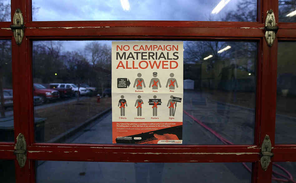 A voting regulations sign is displayed at the Shandon Fire Station in Columbia, S.C., on Saturday.