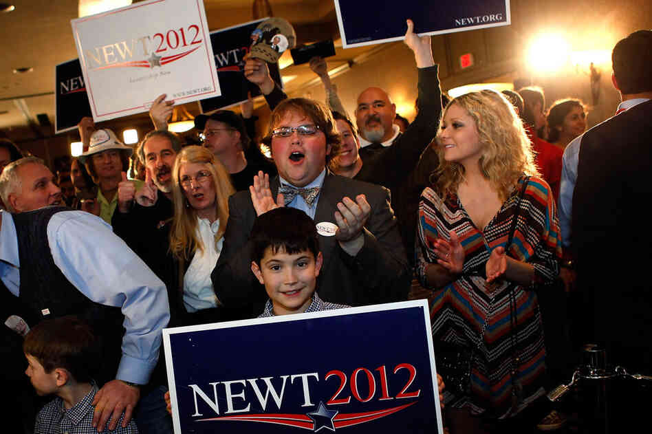 Gingrich supporters celebrate his win at a rally in Columbia.