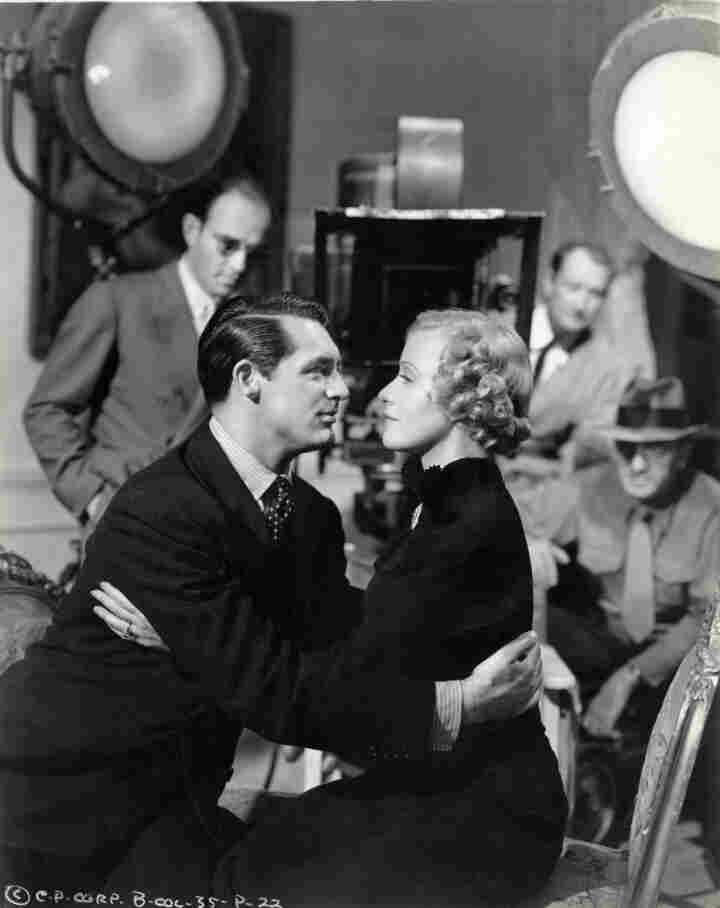 """A snapshot from 1937 catches Cary Grant and Grace Moore filming When You're In Love. This image is included in the exhibit """"On The Set"""" at Deutsche Kinemathek in Berlin."""