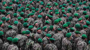 The U.S. military wants Afghan troops to begin taking the lead role in combat operations. Here, Afghan cadets who are joining the army are shown at their graduation ceremony on Dec. 18 in the northern city of Mazar-i-Sharif.