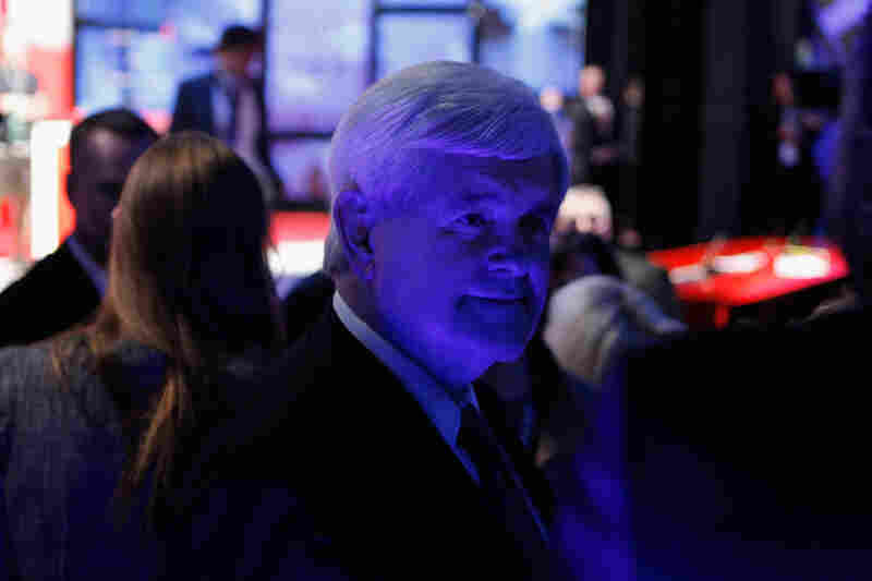 Newt Gingrich steps off stage during a commercial break.