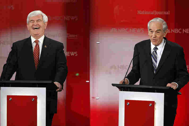 Newt Gingrich, left, shares a laugh with Texas Rep. Ron Paul.